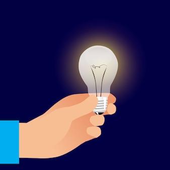 Рука, держащая лампочку. концепция идеи
