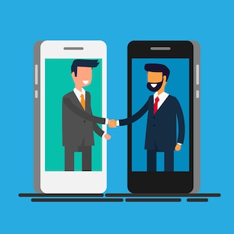 Бизнесмены, пожимая руки через экран смартфона.