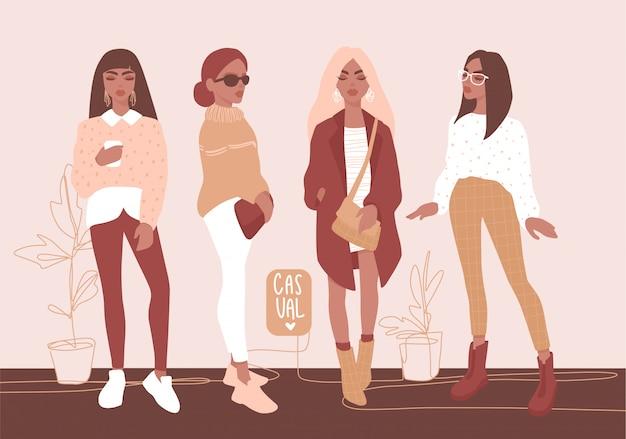 Стильные девушки в модной одежде.