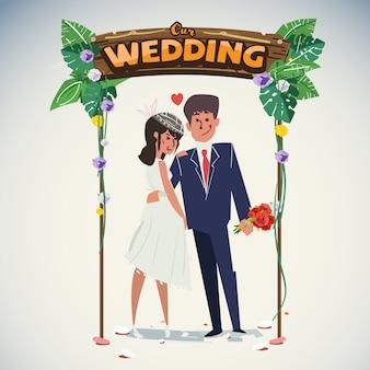 ジャングルの結婚式のアーチとの結婚式のカップル