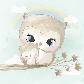 かわいいフクロウの母親と赤ちゃん