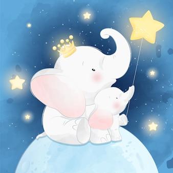 かわいい小さな象の父と息子、月に座って