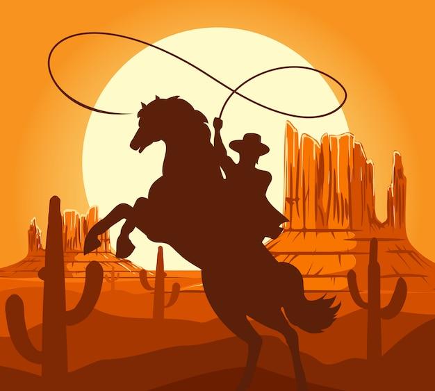 砂漠の西部のカウボーイのシルエット