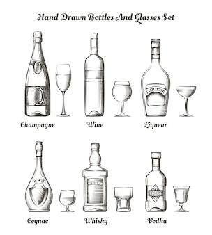 Разные алкогольные бутылки и стаканы