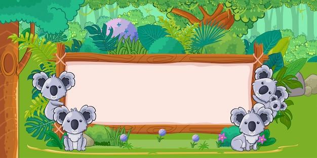 ジャングルの中で空白の看板とコアラ