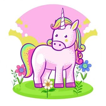 花の草原に立っているかわいいユニコーン