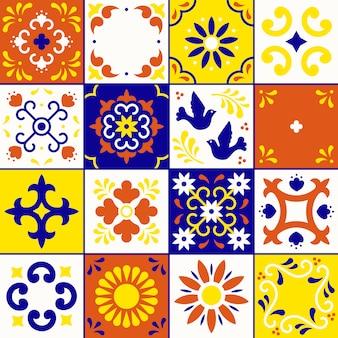 メキシコのタラベラパターン。プエブラの伝統的なスタイルで、花、葉、鳥の装飾が施されたセラミックタイル。