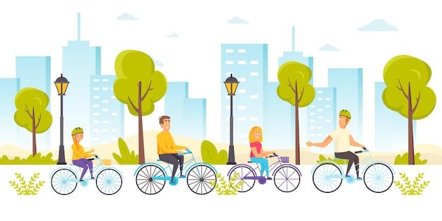Счастливые друзья катались на велосипедах. юноши и девушки на велосипедах в парке