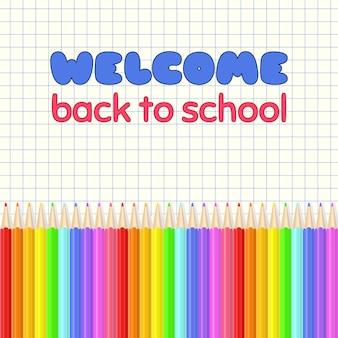 学校へようこそ。虹色のクレヨンが並んでいます。
