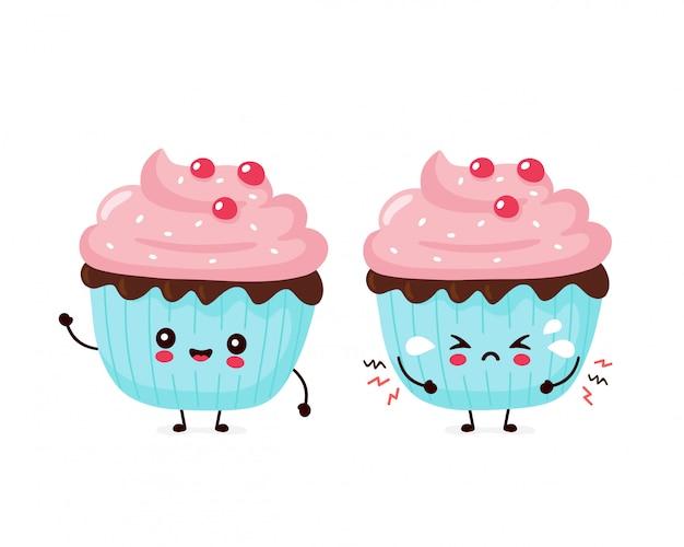 かわいい幸せな笑顔と悲しい叫びカップケーキ。