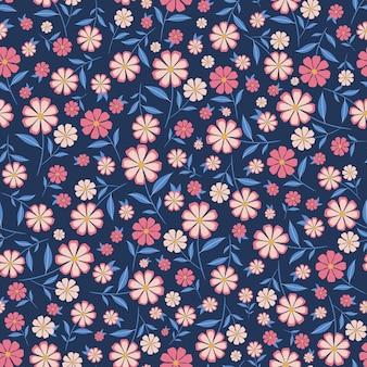 Симпатичные маленькие цветы бесшовные модели с синим фоном