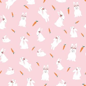 ニンジンのシームレスなパターンを持つかわいいウサギ