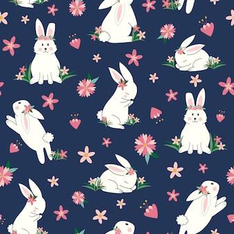 花のシームレスなパターンを持つかわいいウサギ