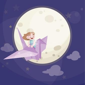 かわいい子供は星と満月で遊ぶ
