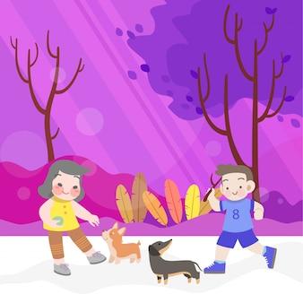 幸せな子供たちは庭で犬と遊ぶ