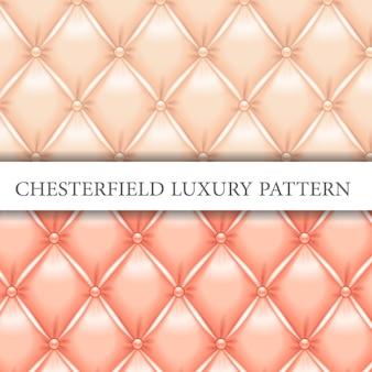 クリーム色とビンテージピンクのチェスターフィールドの豪華なパターン