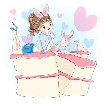 かわいい女の子とウサギがケーキの上に横たわる