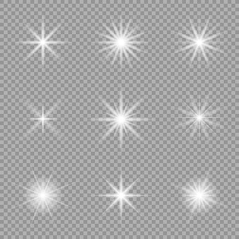 Белый светящийся свет взрывается на прозрачном. сверкающие частицы пыли. яркая звезда.