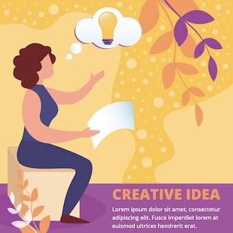 照らされた電球の頭に座っている女性