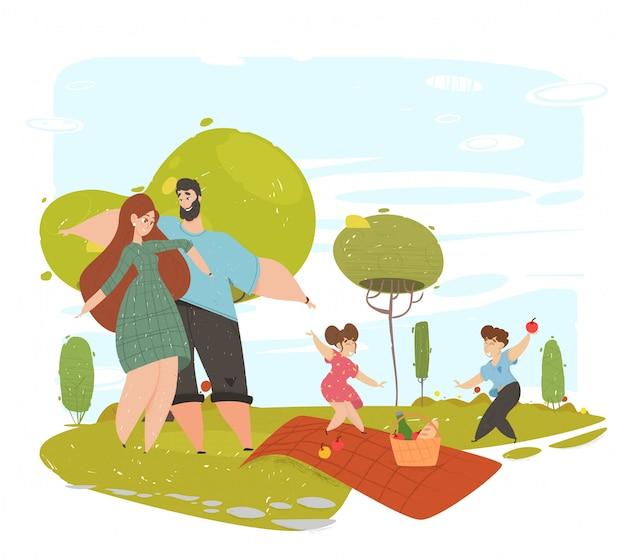 幸せな愛情のある家族は公園でのピクニックに時間を過ごす