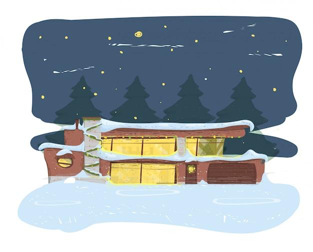 雪の新年の夜に覆われた郊外の家