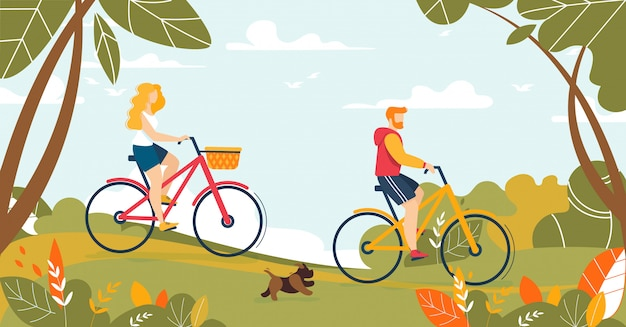 フォレスト内の自転車に乗って男と女のカップル