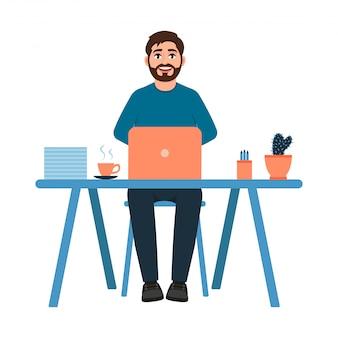 Бородатый парень сидит на рабочем месте