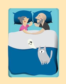 ベッドの中で猫と家族