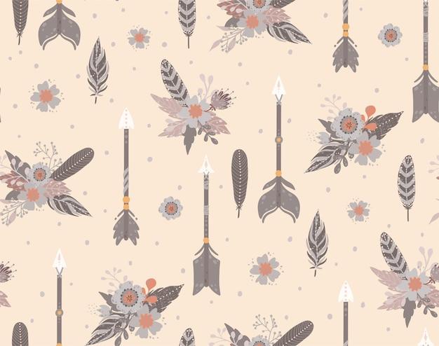 民族の羽、矢印、花のシームレスパターン。