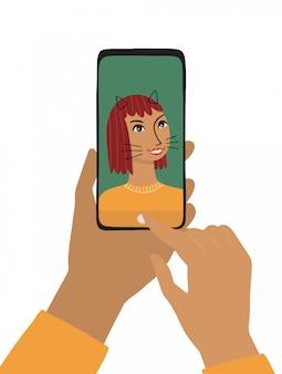 女性の手は、スマートフォンを保持しています。
