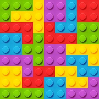 おもちゃのブロックのベクトルの背景。シームレスなパターンベクトル