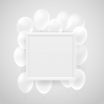 Пустая белая рамка на стене с летающими белыми воздушными шарами