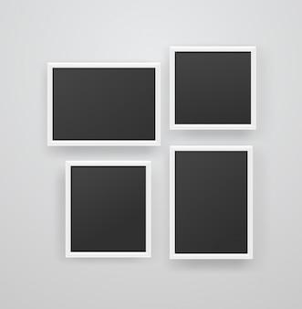 黒の背景を持つ空の白いフォトフレーム