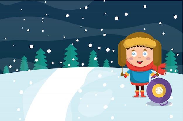 冬の森の背景の中の少年