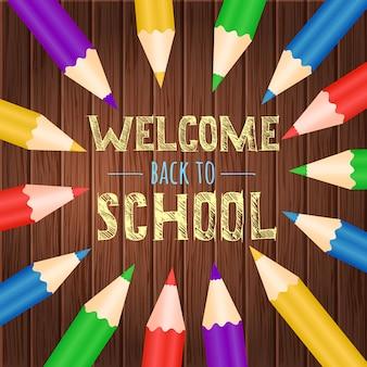 Добро пожаловать обратно в школу с красочными карандашами фоне дерева