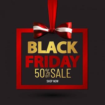 Черная пятница продажа баннер шаблон с красным бантом.