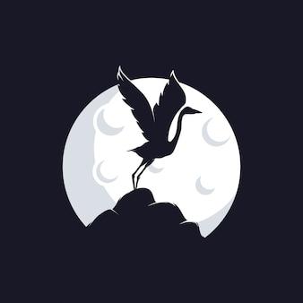 Цапля силуэт против луны