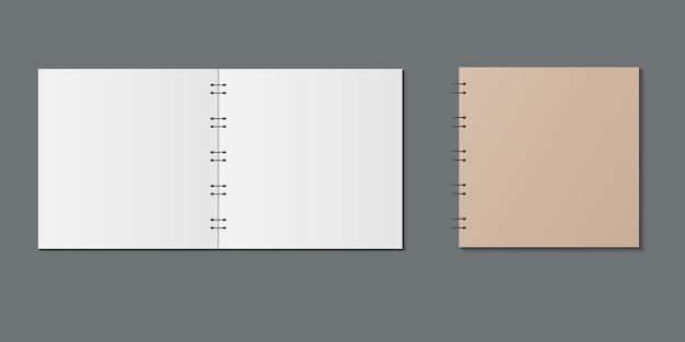 現実的な開閉ノートブック。空白の開いていると閉じている現実的なノートブック。