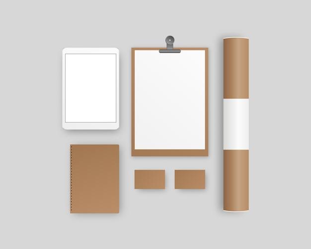Канцелярские товары с буфером обмена, бумага, блокнот, планшет, визитки, бумажная труба. фирменный набор канцелярских товаров. шаблон фирменного стиля.
