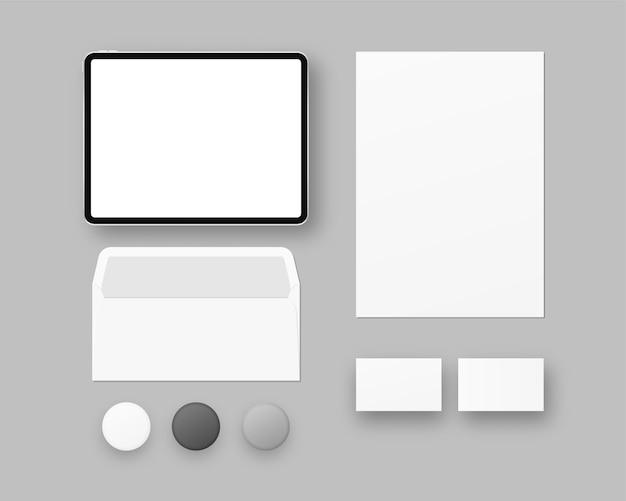 Набор шаблонов фирменного стиля. бизнес канцелярские принадлежности с планшета, бумага, визитки, конверт, значок. , шаблон реалистичная иллюстрация.