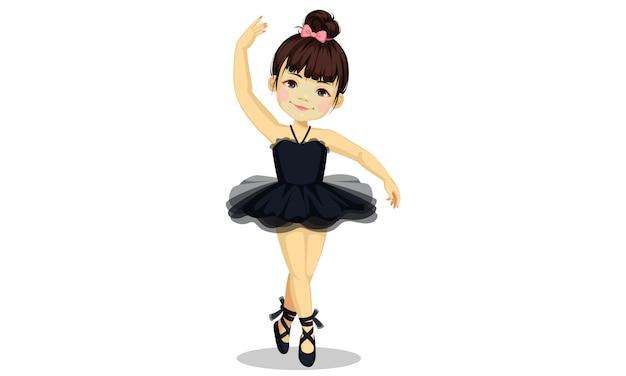 黒のチュチュドレスでかわいい小さなバレリーナの女の子