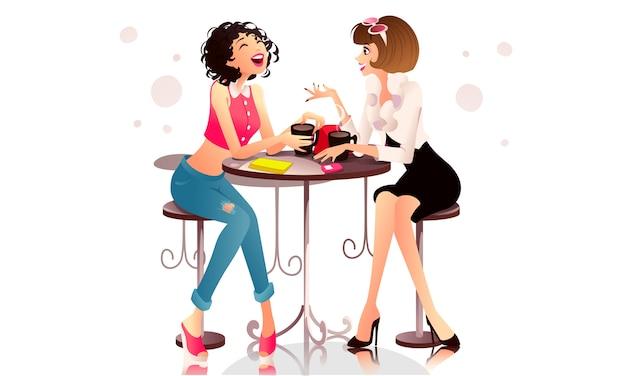 Девушки развлекаются в кафе
