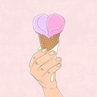 Рука держит любовное мороженое