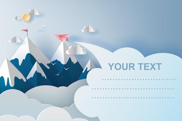 青い空に山の上を飛んでいる飛行機