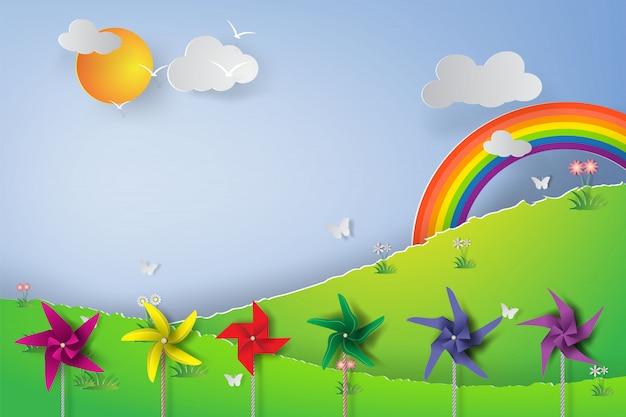 Оригами из красочных ветряных турбин в парке.