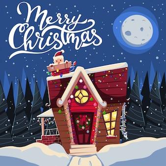 Рождественский домик на снегу украшен гирляндами и с дедом морозом в дымоходе