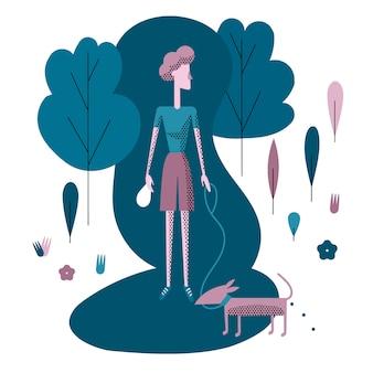Молодая женщина гуляет с собакой в парке