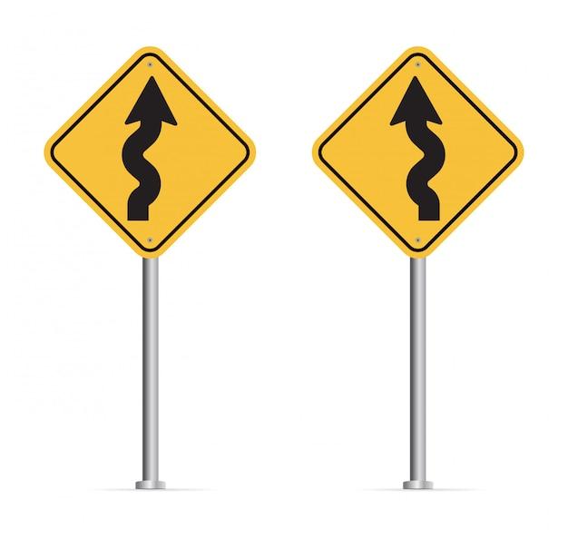 白い背景に分離された曲がりくねった道路標識。
