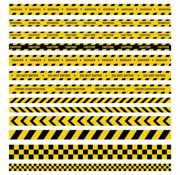 注意と危険のテープ。警告テープ黒と黄色の縞模様。
