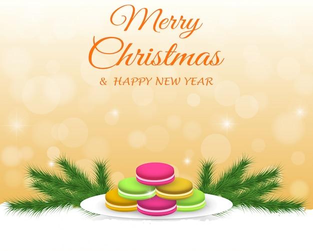 カラフルなマカロン、装飾とクリスマスの背景。